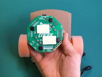 The Crickit and Circuit Playground Express go on the top side of the chassis between