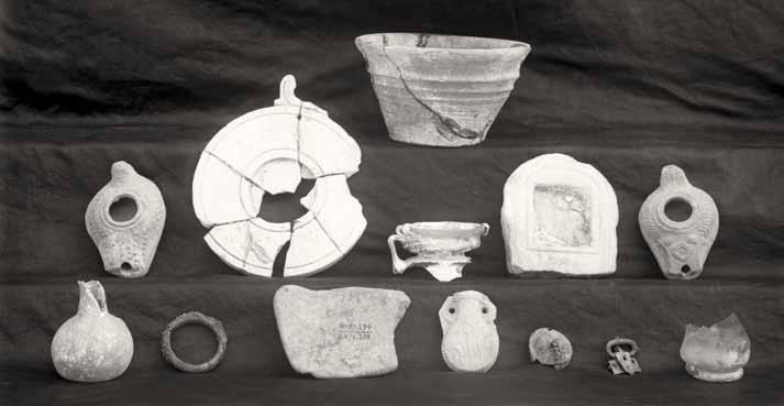 Objects excavated from Tomb 208 of late Romano-Byzantine date, 1926. UPM Image #79608. difficulty.