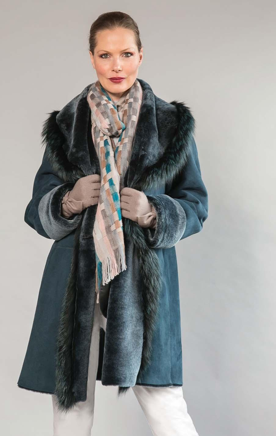 HISO hooded shearling coat with fox trimmed edge. Teal, marsala. $2895 GAYNOR OF ITALY basket weave scarf.