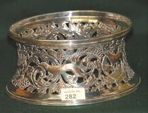 282 Large Silver Plated Dish Ring with heavily pierced frieze. 283 Large silver plated two handled Octagonal shaped Tray with raised gallery on bun feet. 284 Silver Tennis Trophy Chester 1932.