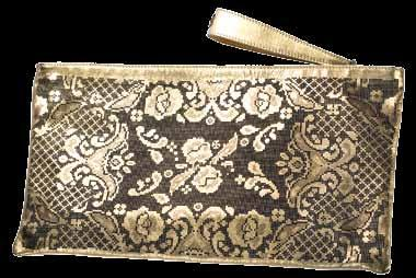 An example of fine European quality with an artistic flair from the East, the sides of the clutch depict a floral and lattice motif that fasten with a metallic gold handled-zip.