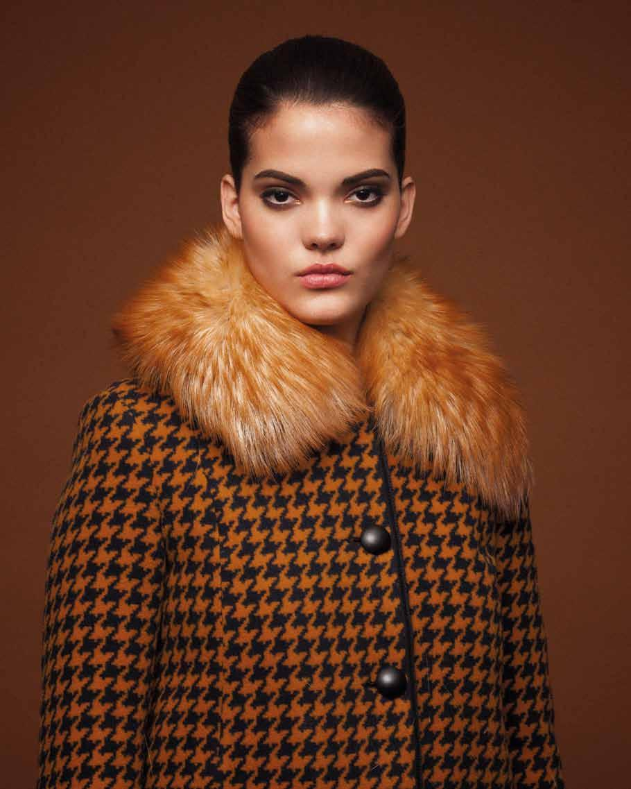 110 111 Opposite Page: Black and Mustard Printed Coat with Fur
