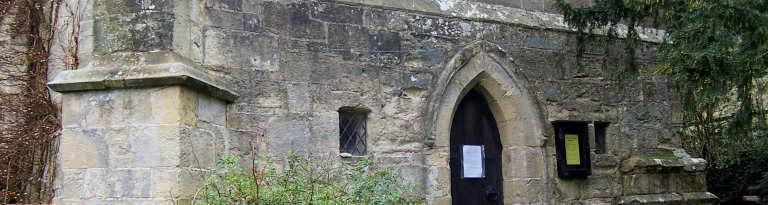 and relatively narrow lancet-arched doorway, as well as some of