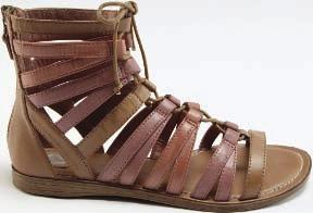 SHOES A Report leather sandal. over the top Spring footwear focuses on heavily detailed looks. By Katherine Bowers A BASIC, UNADORNED SHOE HAS virtually no reason to exist anymore.