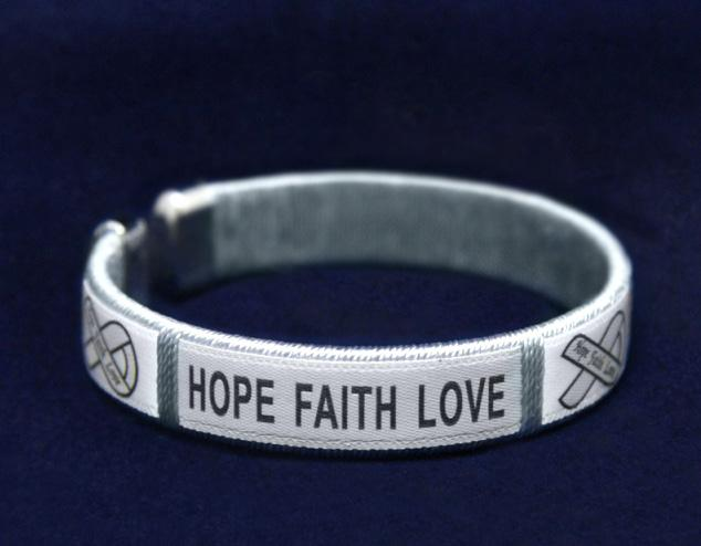 Sterling silver plated bracelet that has charms that say, Hope, Faith, Love along with ribbon charms.