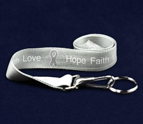 Each 4 inch gray ribbon magnet has the words Find The Cure.