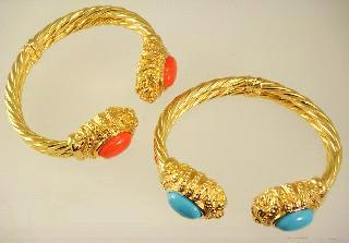 $125 - $175 Lot # 462 463 Lot # 464 464 465 14k yellow gold turquoise and coral mounted bracelets. $1,500 - $2,000 14k yellow diamond and pink sapphire ring.