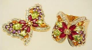 $500 - $700 14k yellow gold citrine, diamond and pink sapphire ring.