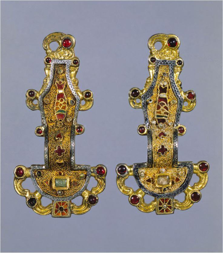Merovingian, Anglo Saxon Pair of Merovingian looped fibulae, France 500 s. Fibula, decorative pins favored by romans and etruscans, fastening garments. Incorporated inlaid precious stones.
