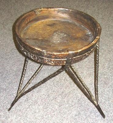 Furniture 2005.732 Tripod table stand Wood, iron / hand-crafted Iron tripod with nine twisted legs, six to hold edge of bowl, three to support underside of bowl.