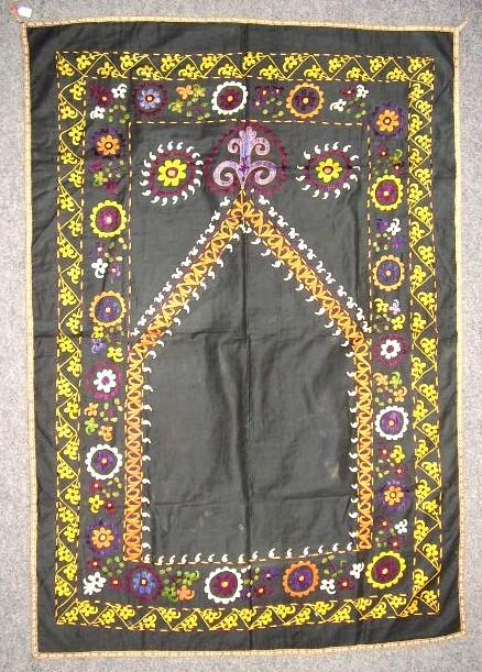 Embroidery 2005.755 Wall hanging Cotton, silk / hand-embroidered Rectangular wall hanging, prayer niche with two stylized ram horns at top.