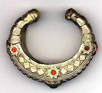 Jewelry 2005.768 Bracelet Silver alloy, brass, glass / hand-crafted Small open hollow silver bracelet with rounded brass terminals, inner surface lined with brass.
