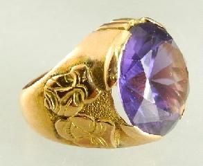 $750 - $1,000 460 14K yellow gold and sapphire ring. 461 Gemstone globe on stand.