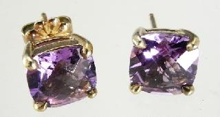 bracelet. Lot # 572 572 573 574 575 576 577 578 579 580 581 582 Pair of Tiffany & Co. sterling silver and amethyst stud earrings, w. cons. appraisal. Ivory boar tusk pendant with gold coloured mounts.