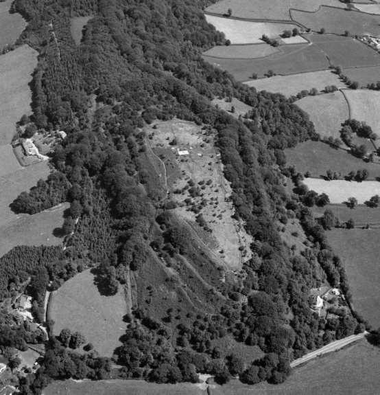 Resource 5 Aerial Photograph of Hembury Aerial Photograph of Hembury Hillfort taken in 1984 showing a small part of the large defensive ramparts and deep ditches. The rest are covered by trees.