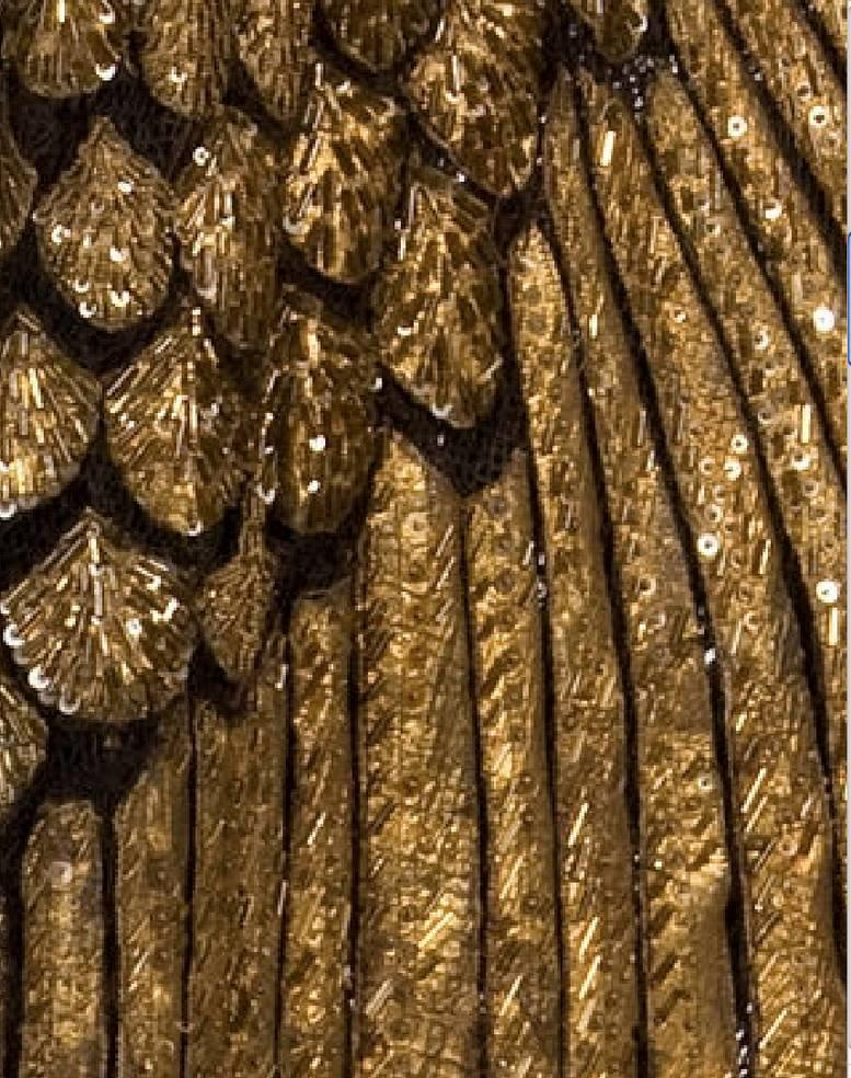 We printed two copies. One was cut into sections, then each feather in a section was numbered and cut out to use as a pattern for cutting the gold fashion leather.