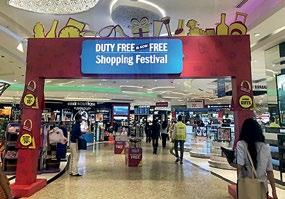 INTERNATIONAL SHOPPING GUIDE Mumbai Duty Free. Below: The festival is hard to miss with flashy banners put up.
