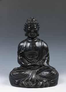 H: 7cm Estimate CA$500 - CA$800 042 硬木佛像 ROSEWOOD BUDDHA FIGURE Depicted seated in dhyanasana, hands held in dhyana mudra with a lotus, dressed in long flowing robes, the chest marked with the wan