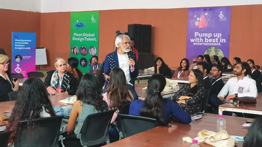 Sunil Sethi, pesident of the Fashion Design Council of India interacting with participants. participants to reinterpret the sketch for the new millennium.
