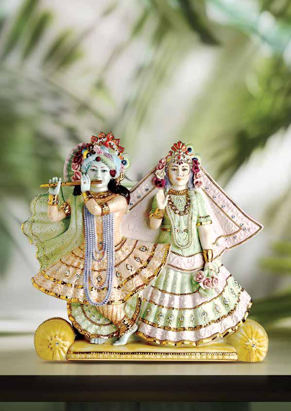 Blissful Divinity Beautiful idols of Lord Krishna and Radha featuring