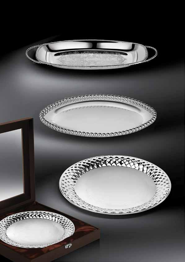 Breathtaking in silver Spectacular trays in silver that feature dainty and ornate carvings for an opulent aura.