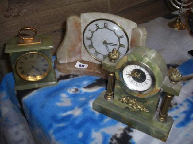Two Onyx clocks, 1 carriage and 1