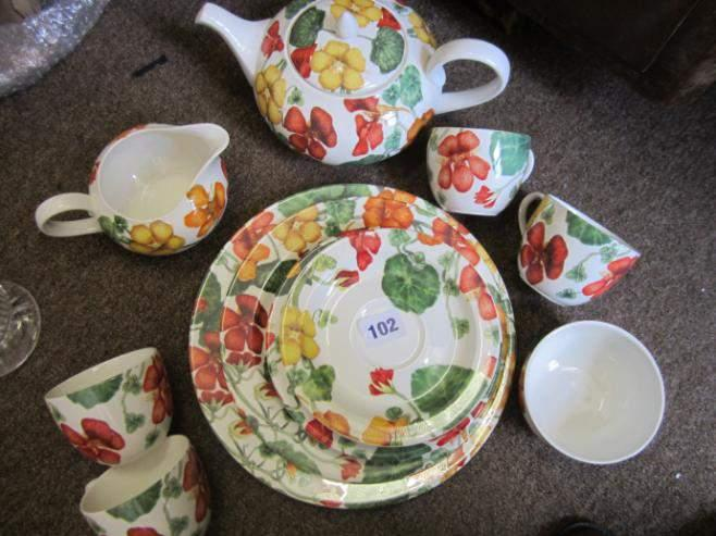 "Poole Pottery ""Nasturtium"" tea set comprising teapot, milk jug,"