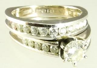 $2,500 - $3,000 457 14K White & Yellow Gold Diamond ring.