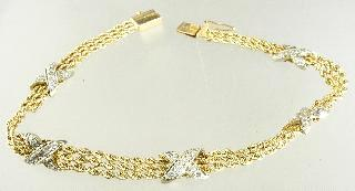 543 544 545 546 547 548 549 550 551 552 Lot # 553 553 14k yellow gold and white gold bracelet, with consignor's appraisal. $250 - $500 554 Pair of 18k yellow gold and pink topaz earrings.