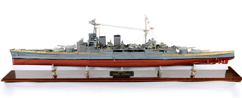Lot 301 301 A MODEL OF THE BRITISH ROYAL NAVY BATTLECRUISER 'H.M.S. HOOD' of mixed material construction, approximately 133cm long, in a glazed display case, overall 138cm long.