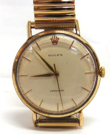 10 ROLEX PRECISION a lady's 14 carat white gold mechanical bracelet watch, London 1973, the rounded rectangular 'shot silk' white dial with black steel batons, black hands, the two piece case to an