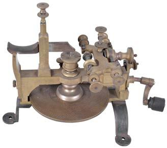 hardware, screw feed adjustment for positioning cutting spindle, 5.25 inch diameter brass dividing plate with 30 rows of holes, the counts ranging from 11 to 360, 19th century. $800-$1000 8.75in x 6.