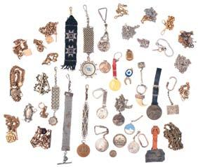 Railroad related pins, fobs, and buttons, all 10 karat gold, and with enamel, including Brotherhood Railway Carmen, Ladies Auxiliary to the Brotherhood of Railway Trainmen,