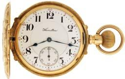numeral, double sunk white enamel dial, plum colored steel spade and poker hands, serial #5441567, c1930. $1800-$2500 1038 American Waltham Watch Co,