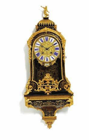 143 143 a french louis XV cartel clock in boulle style with gilt bronze mounting, marquetry of tortoiseshell and brass, dial with plaques of white enamel with blue roman numerals.