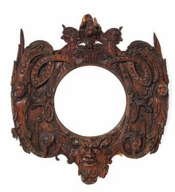 171 171 A Baroque oak carving/picture frame carved with leaf ornaments, grotesques and Satyr masks. Outer measurements C. H. 130 cm. W. 140 cm. Inner measurements H. 58 cm. W. 56 cm.