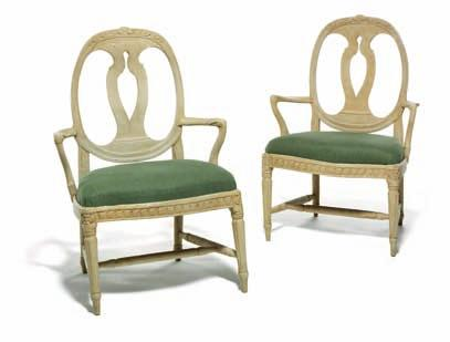 DKK 30,000 / 4,000 205 206 a pair of Gustavian grey painted armchairs with oval backs carved with flowers, round