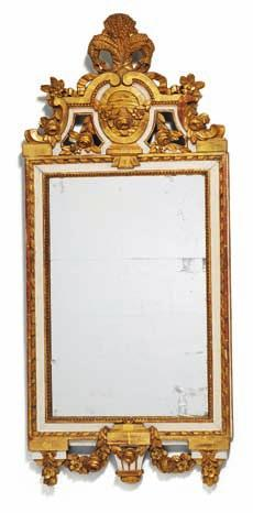 209 a Gustavian giltwood and white painted mirror, carved