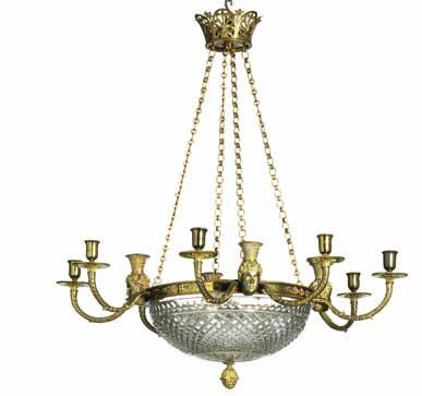 273 a gilt bronze and cut glass, twelve light chandelier decorated with masks.