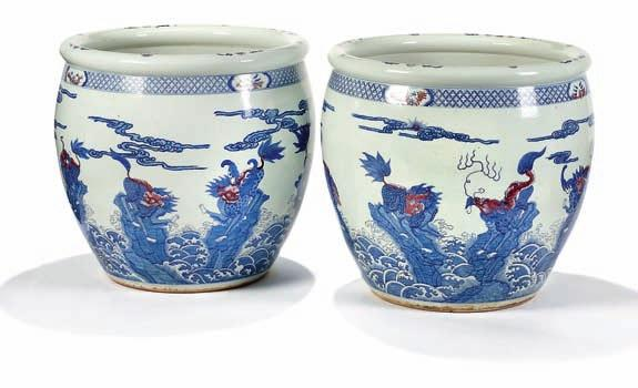 323 323 a pair of large porclain fish basins, decorated in underglaze blue and cobberred with kilin among clouds. China, 19th century. H.