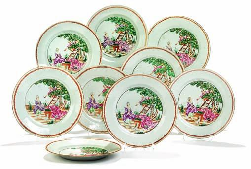 326 326 nine Chinese famille rose plates - two deep plates and seven flat, decorated in colours and gold in european style, centre with