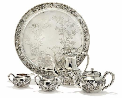 331 331 Chinese export silver tea service, engraved and applied with birds, bamboo and lotus flowers, bamboo shaped handles, comprising teapot, creamer, sugar bowl and tray.