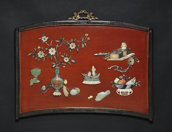 332 332 Chinese brown lacquer crescent-shaped zitan framed panel carved with thunder and cloud symbols and the sides carved with inverted scroll with a diaper ground.