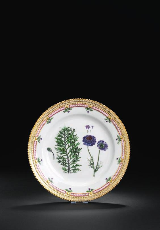 "420 rare ""Flora danica"" porcelain plate, decoratede in colours and gold with scabiosa columbaria. Fl. danica: Tab: ccchiv F:6. The royal copenhagen Porcelain manufactory, ca 1775-1805. diam. 25 cm."