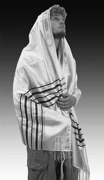 13. Two Special Traditions in Jewish Garments 303 Fig. 13.6: A man wrapped with tallit (mantle) and Tzitzit are attached to the four corners. Courtesy of The Galilee Experience. Fig. 13.7: Modern Tzitzit wikipedia, photographer Drosenbach.
