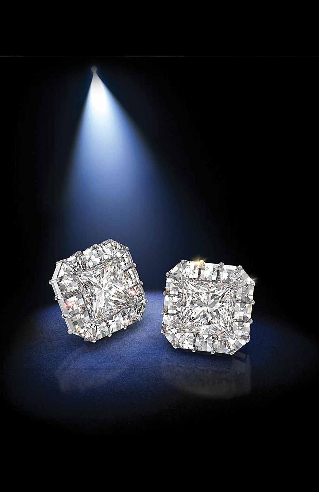 Earrings of Fire Earrings of Fire with Blaze diamonds around princess centers. A. Ring of Fire features our exclusive diamond halo.