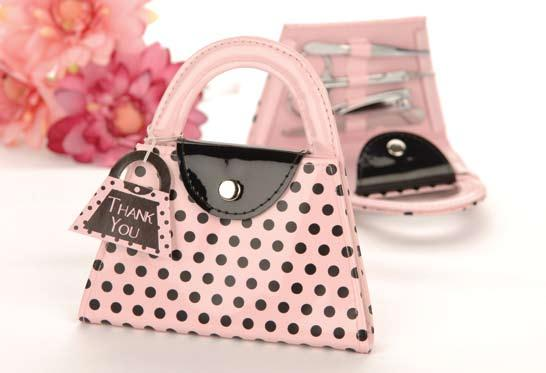 Pink Polka Purse Manicure Set Four-piece, stainless-steel set includes nail file, scissors, clippers and