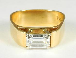 $7,000 - $9,000 14k yellow gold and jade ring.